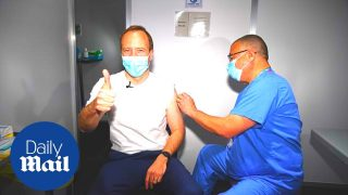 UK Covid-19: Matt Hancock gets AstraZeneca vaccine from Jonathan Van-Tam
