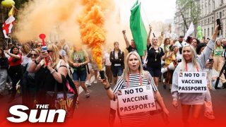 Anti-vaccine passport protesters march in London standing against Covid-19 government mandates