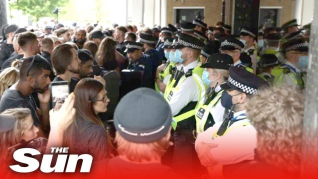 Anti-vaccine protesters try to storm BBC studios as they clash with cops during rally